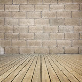 Wooden floor and brick wall Royalty Free Stock Images