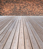 Wooden floor and brick wall Stock Photos