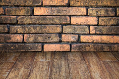 Wooden floor and brick wall background Royalty Free Stock Images