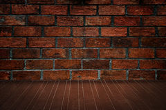 Wooden floor and brick wall stock photo