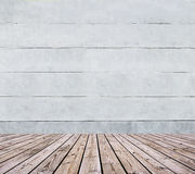 Wooden floor and concrete wall Stock Photo