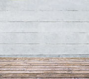 Wooden floor and concrete wall Royalty Free Stock Image