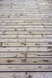 Wooden floor constructed from teak wood lumber planks Royalty Free Stock Image