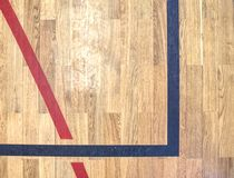 Wooden Floor Court. Gym for playing futsal, mini-football. White Line On Wooden Floor Court. Gym for playing futsal, mini-football.  Plank pier in the light of stock photo