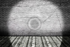 Wooden floor with cracked brick wall Royalty Free Stock Photo