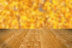 Wooden floor and defocused autumn forest Royalty Free Stock Photography