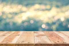 Wooden floor in front of abstract bokeh background Royalty Free Stock Image