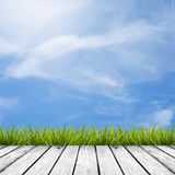 Wooden floor and grass under sky Stock Photo