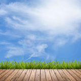 Wooden floor and grass under sky Stock Image