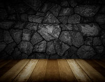 Wooden floor and gray cracked stone wall background Stock Images