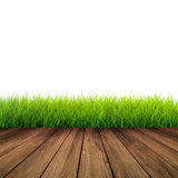 Wooden floor with green grass Royalty Free Stock Image