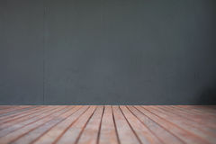 Wooden floor and grey wall background Stock Images