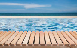 Wooden floor with infinity pool stock images