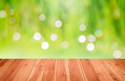 Wooden floor inside green Bokeh for background Stock Photography