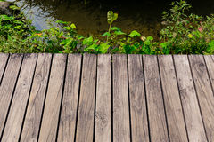 Wooden floor with lake Stock Photography