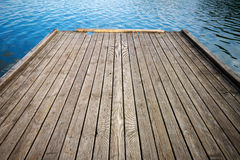 Wooden floor and lake Stock Images