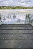 Wooden floor on the lake Stock Images