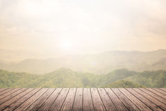 Wooden floor with mountain landscape blurred background Stock Photo
