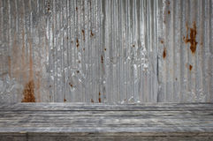 Wooden floor with old metal sheet roof texture. Pattern of old metal sheet. Royalty Free Stock Image