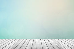 Wooden floor with pastel sky blurred background. Gray (Grey) wooden floor with abstract turquoise blurred background in pastel sky tone color. use for backdrop royalty free stock image