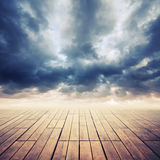 Wooden floor with perspective and stormy skн Royalty Free Stock Photos