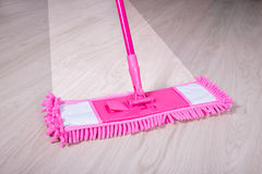 Wooden floor with pink mop - before and after concept Royalty Free Stock Photos