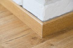 Wooden floor plinth. Interior details. Loft style Royalty Free Stock Photo