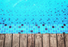 Wooden floor and pool side Royalty Free Stock Photography