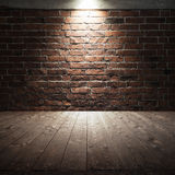 Wooden floor and red brick wall with spot light Royalty Free Stock Photography