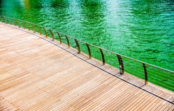 Wooden floor on the riverbank Royalty Free Stock Photos