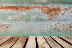 Wooden floor on rusted tile background. Stock Images