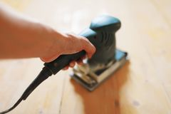 Free Wooden Floor Sanding With Flat Sander Tool Royalty Free Stock Photo - 159468275