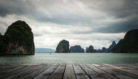 Wooden floor on the sea at phang nga bay, thailand. Wooden floor on the sea at phang nga bay with rain cloud, thailand Royalty Free Stock Images