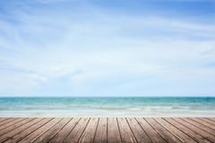 Wooden floor with sea and sky blurred background Stock Images