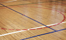 Wooden floor in sports hall with colorful lines Stock Photo