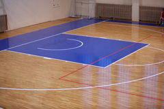Wooden floor of sports hall with marking lines Royalty Free Stock Photo