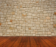 Wooden floor with stone wall Stock Images