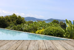 Wooden floor with swimming pool overlooking view andaman sea mou Stock Photos