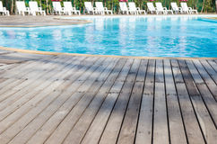 Wooden floor beside swimming pool Stock Images