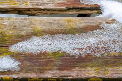 Wooden floor table or bridge covered snow.  royalty free stock photos