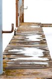 Wooden floor table or bridge covered snow.  stock image