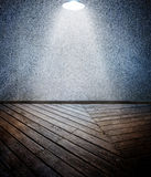 Wooden floor with textured wall Royalty Free Stock Image