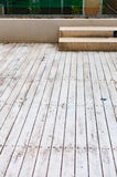 Wooden floor tiled outdoor beside swimming pool Stock Images