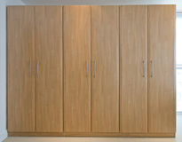 Wooden floor to ceiling wardrobes Stock Photography