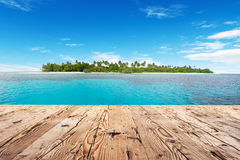 Wooden floor and tropical island on background Royalty Free Stock Image