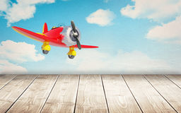 Wooden floor with vintage airplane Royalty Free Stock Photography