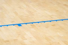 Wooden floor volleyball, basketball, badminton, futsal, handball court with light effect Wooden floor of sports hall with marking. Lines line on wooden floor royalty free stock photo