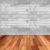 Wooden floor and white marble wall Royalty Free Stock Image