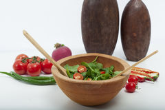 Wooden on floor,  wooden in green salad,  tomato and pepper Stock Photos