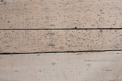 Wooden floor with woodworm traces Royalty Free Stock Photography